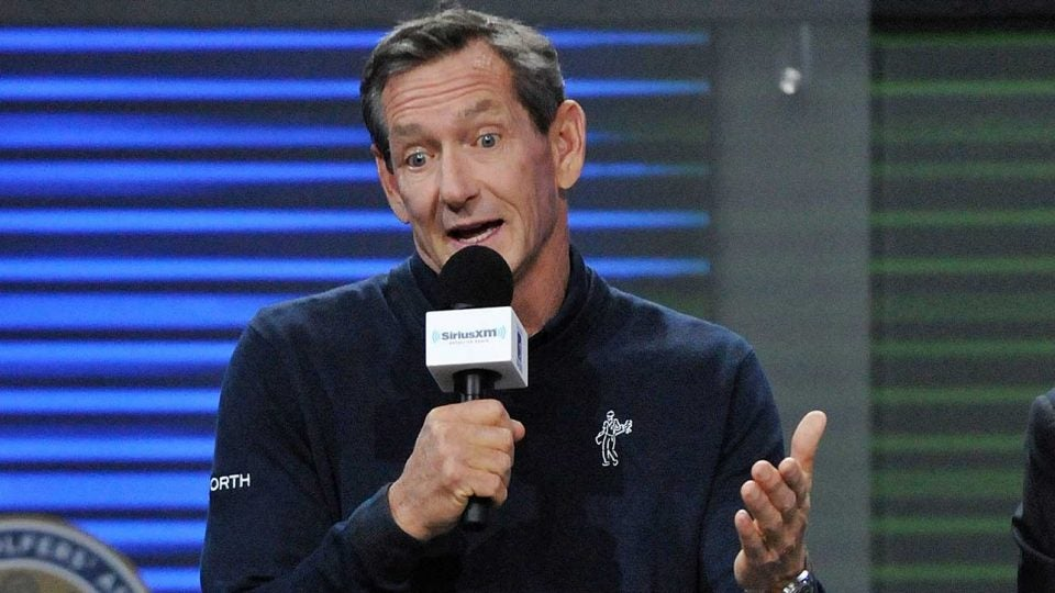 Hank Haney speaks on stage.