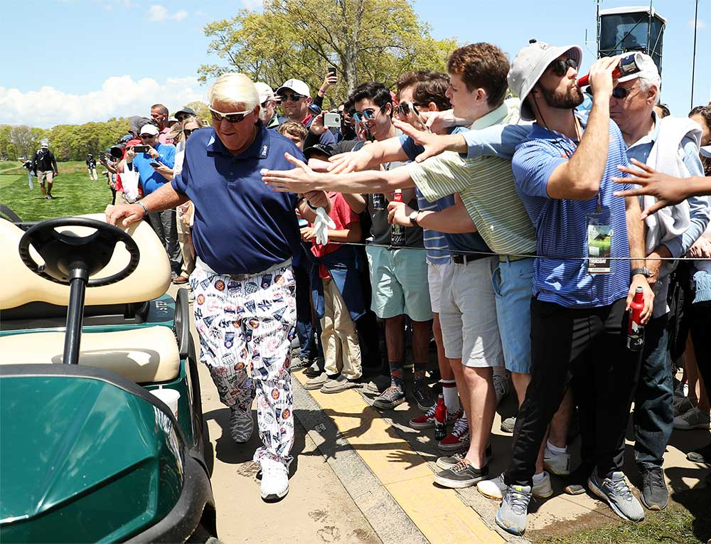John Daly settles into his cart during the first round of the PGA.