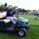 John Daly drives a cart during Thursday's opening round of the PGA Championship.