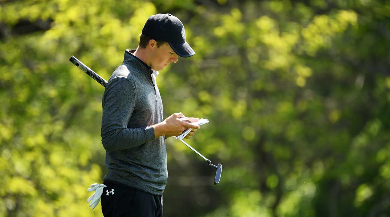 Jordan Spieth reads a putt during Friday's second round of the PGA Championship.