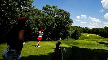 An Alabama player tees off during the 2018 Division I Women's Golf Championships.