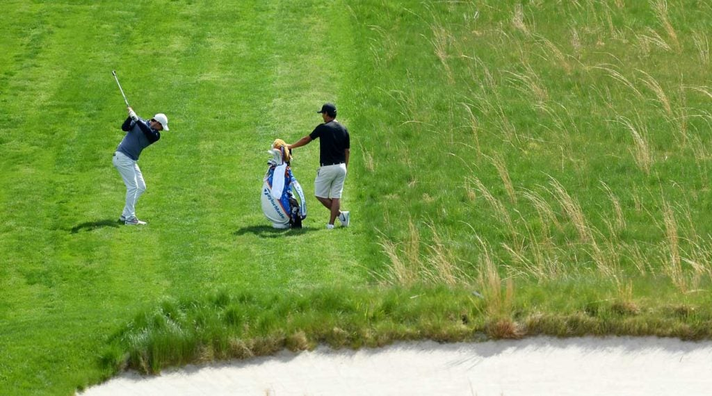 Rory McIlroy and his caddie Harry Diamond on the 18th hole at Bethpage Black.