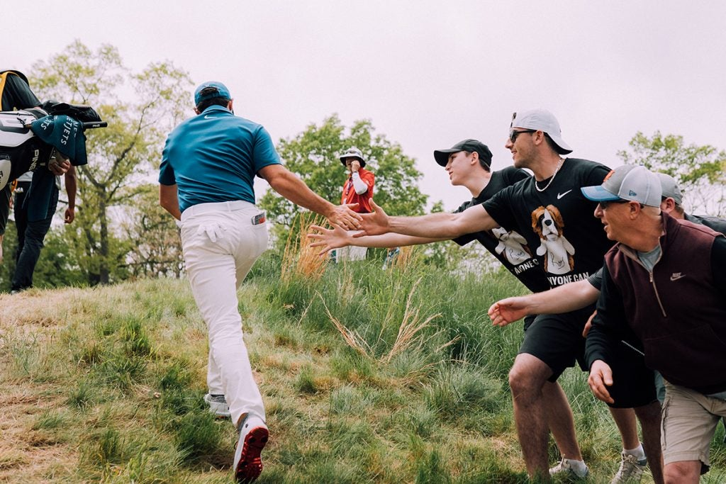 Rory gives a few spectators some love.