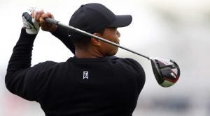 Tiger Woods hits driver during a PGA Championship practice round.