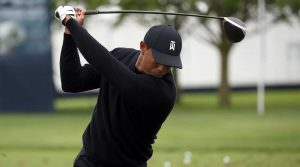 Tiger Woods swings his driver.