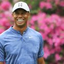Tiger Woods smiles during a Masters round.