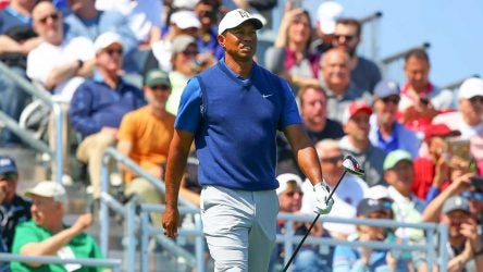 Tiger Woods walks off the tee during the first round of the 2019 PGA Championship.