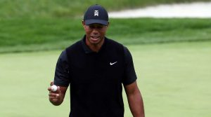 Tiger Woods waves to the crowd at the PGA Championship.