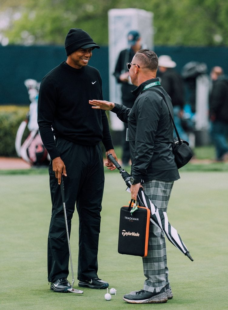 Tiger and Sean Foley have a quick chat.