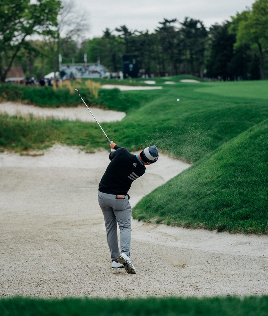 Xander blasts one from a not-so-easy fairway bunker.