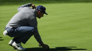 FARMINGDALE, NEW YORK - MAY 15: Justin Rose of England lines up a putt during a practice round prior to the 2019 PGA Championship at the Bethpage Black course on May 15, 2019 in Farmingdale, New York. (Photo by Patrick Smith/Getty Images)