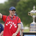 HAMILTON, ONTARIO - JUNE 09: Rory McIlroy of Northern Ireland wears a Toronto Raptors jersey after he won the RBC Canadian Open at Hamilton Golf and Country Club on June 09, 2019 in Hamilton, Canada. (Photo by Michael Reaves/Getty Images)