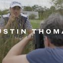 Justin Thomas being photographed.