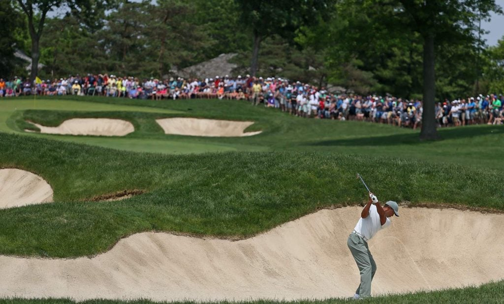 Woods's hot round came undone in the sand trap on the 10th hole.