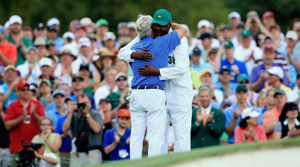 Ben Crenshaw hugs longtime caddie Carl Jackson on the 18th green after playing in his final Masters during the second round of the 2015 Masters.