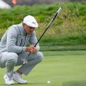 Bryson DeChambeau lines up a putt during the first round of the 2019 U.S. Open at Pebble Beach Golf Links.