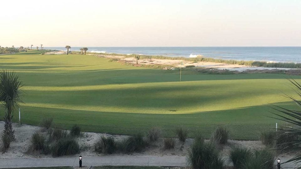 The 18th hole at the Ocean Course at Hammock Beach Resort runs right along the beach.