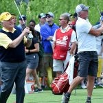 Jack Nicklaus and Brett Favre hit golf balls on the range together at the American Family Insurance Championship.