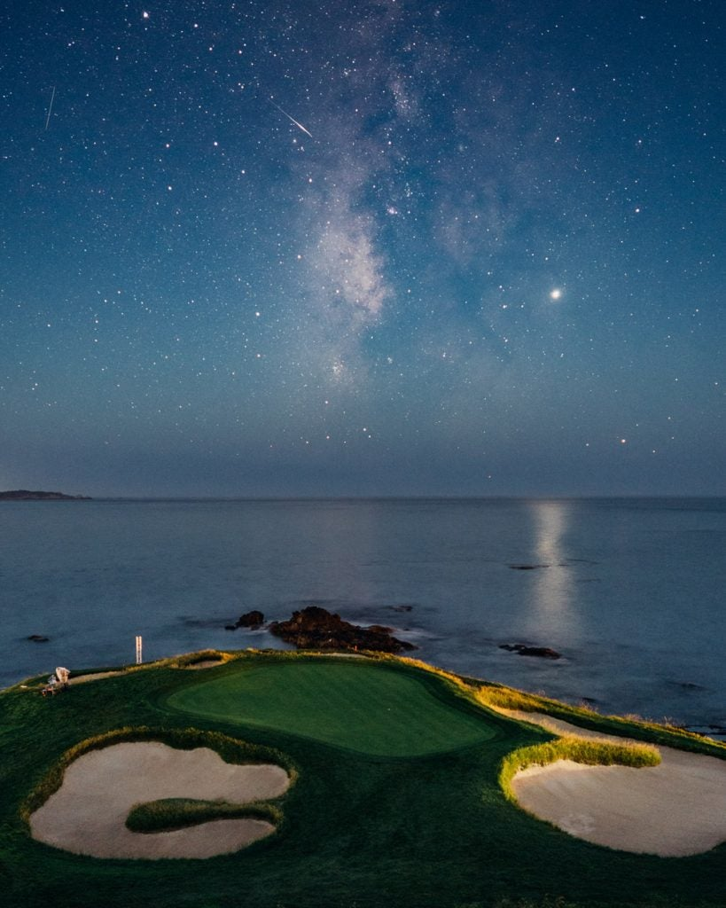 The par-3 7th hole at Pebble Beach Golf Links with the Mikly Way above, as shot by Christian Hafer.