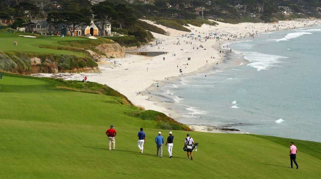 Players play the 9th hole at Pebble Beach in preparation for the 2019 U.S. Open.