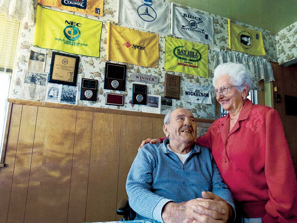 Plaques and autographed flags lined the walls of Jennie and Al's San Diego kitchen, one for each of their grandson's wins.