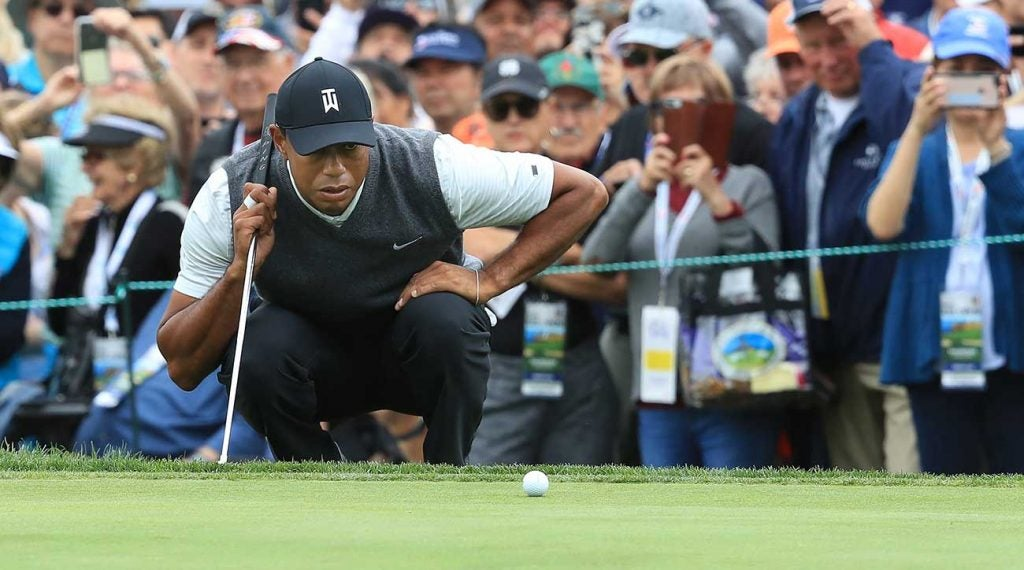 Tiger Woods lines up a putt in the first round of the U.S. Open.