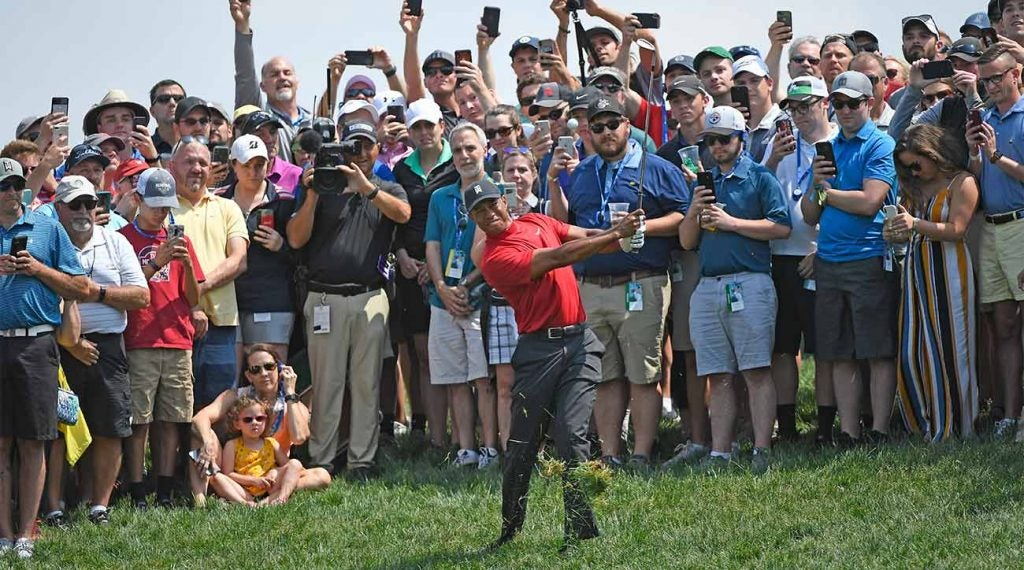 Tiger Woods blasts a shot out of the rough during the final round of the Memorial on Sunday.