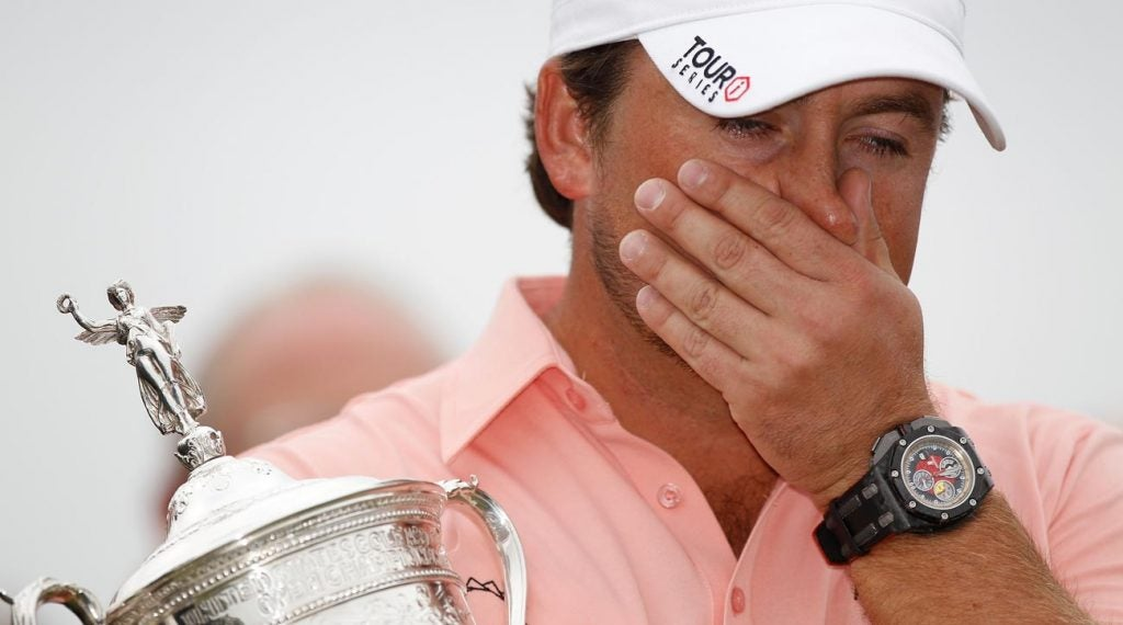 Graeme McDowell gets emotional after accepting the 2010 U.S. Open trophy at Pebble Beach.
