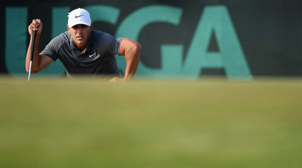 Brooks Koepka, winner of the last two U.S. Opens, lines up a putt at Shinnecock Hills in 2018.