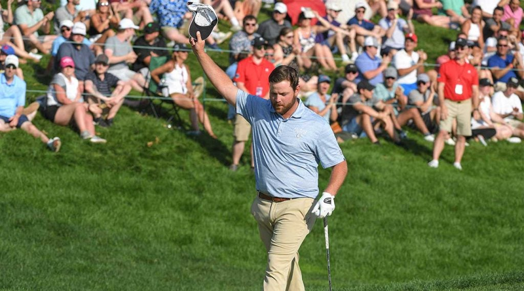 Zack Sucher celebrates his chip-in par on the final hole of the Travelers Championship.