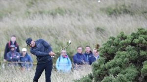 Brooks Koepka hits out of the rough on the 17th hole during the first round of the Open Championship at Royal Portrush Golf Club.