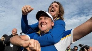 PARIS, FRANCE - SEPTEMBER 30: Ian Poulter and Tommy Fleetwood celebrate victory after the singles matches of the 2018 Ryder Cup at Le Golf National on September 30, 2018 in Paris, France. (Photo by Richard Heathcote/Getty Images)