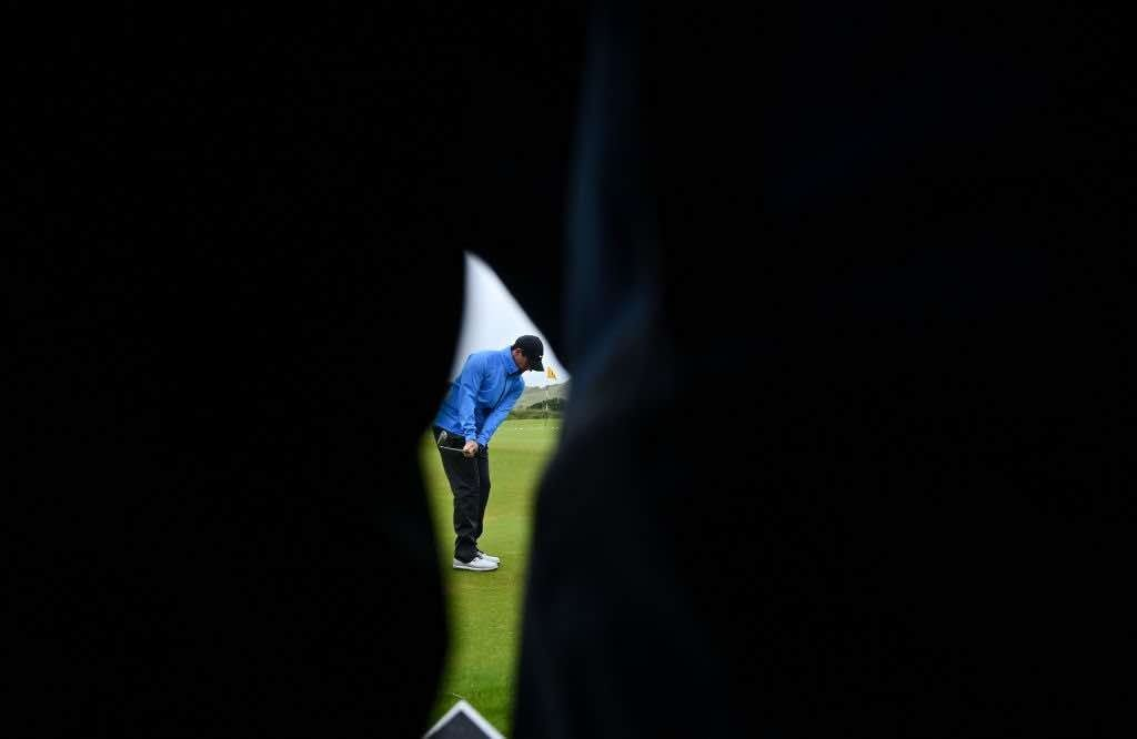 Antrim , United Kingdom - 17 July 2019; Rory McIlroy of Northern Ireland is seen through a gallery on the practice range during a practice round ahead of the 148th Open Championship at Royal Portrush in Portrush, Co. Antrim. (Photo By Brendan Moran/Sportsfile via Getty Images)
