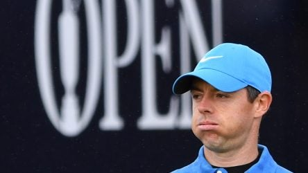 Northern Ireland's Rory McIlroy walks down the fairway from the first hole during the first round of the British Open golf Championships at Royal Portrush golf club in Northern Ireland on July 18, 2019. (Photo by Paul ELLIS / AFP) / RESTRICTED TO EDITORIAL USE (Photo credit should read PAUL ELLIS/AFP/Getty Images)