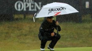 PORTRUSH, NORTHERN IRELAND - JULY 21: Shane Lowry of Ireland shelters from the rain as he lines up a putt on the eighth green during the final round of the 148th Open Championship held on the Dunluce Links at Royal Portrush Golf Club on July 21, 2019 in Portrush, United Kingdom. (Photo by Mike Ehrmann/Getty Images)
