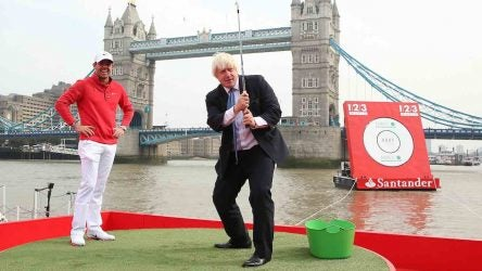 LONDON, ENGLAND - SEPTEMBER 18: Rory McIlroy laughs as Mayor of London Boris Johnson hits a golf Ball during the launch of 1,2,3 World with Rory McIlroy at Potters Field, Tower Bridge on September 18, 2014 in London, England. (Photo by Andrew Redington/Getty Images for Santander) *** Local Caption *** Rory McIlroy; Boris Johnson *** Local Caption *** Rory McIlroy; Boris Johnson