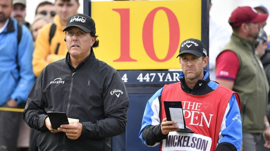 Phil Mickelson with caddie on the 10th tee during the first round of The Open Championship.