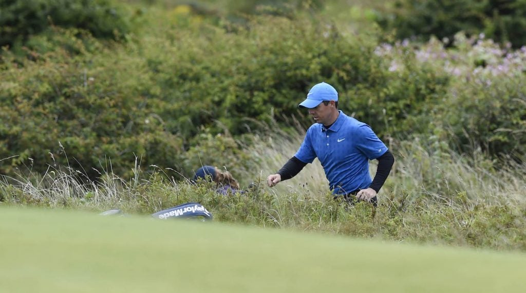 Rory McIlroy climbs out of the rough on the 5th hole during the first round of The Open Championship.