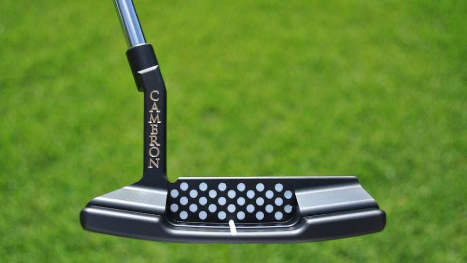 The 32 silicone dots represent Scotty Cameron's age when he came up with the design for the original Newport TeI3 putter.