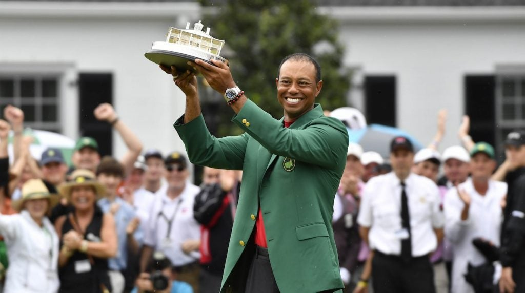 Tiger Woods celebrates with the green jacket after winning the 2019 Masters.
