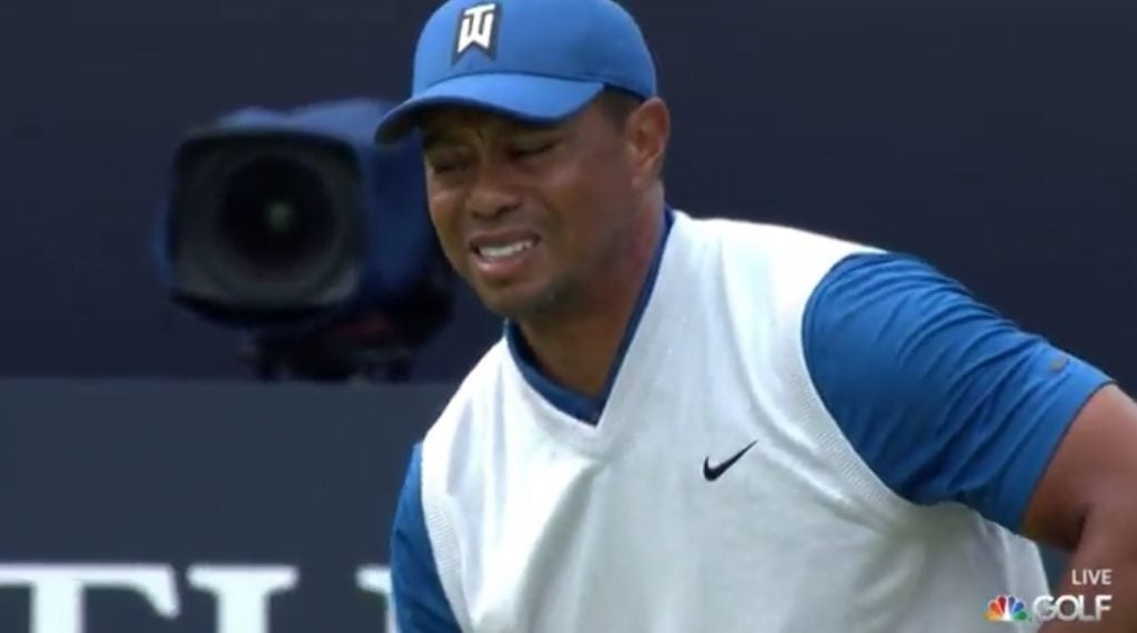 Tiger Woods grimacing after his first tee shot on Thursday,