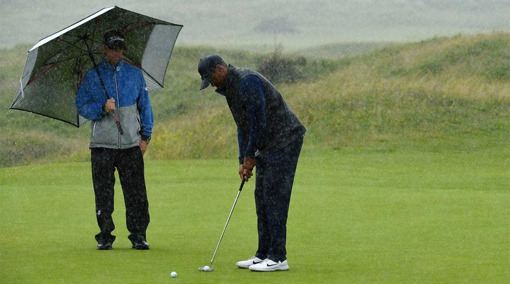 Tiger Woods lines up a few putts on the putting green on Wednesday at the British Open.