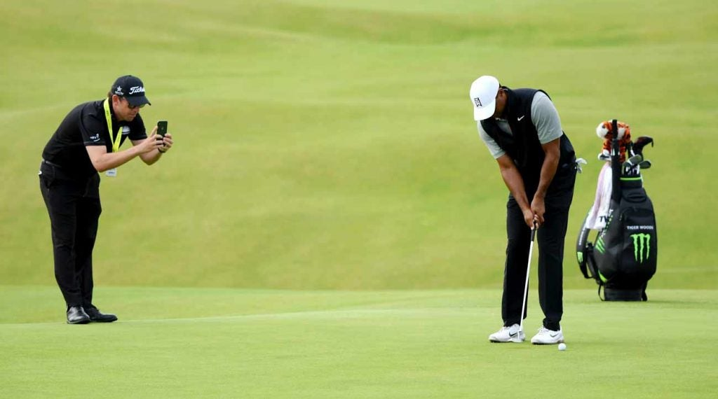 Matt Killen takes a photo of Tiger Woods' putting stroke at Portrush on Tuesday.