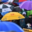Spectators with umbrellas at the 2019 British Open.