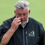 Darren Clarke walks off the green at the 2019 British Open.