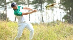 Matt Wallace hits out of the rough at the Scottish Open.