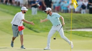 Matthew Wolff celebrates his 3M Open win with his caddie.