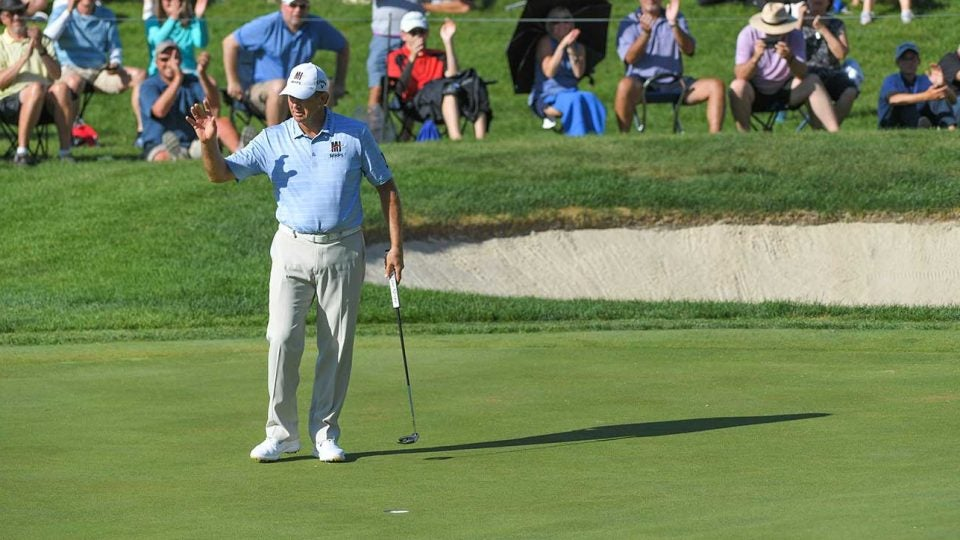 Retief Goosen waves to the crowd at the Senior Players on Sunday.