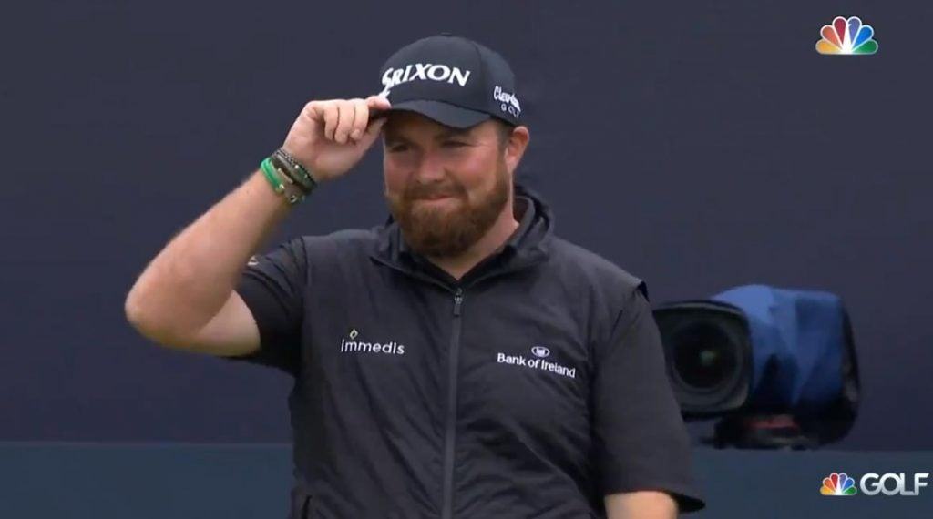 Shane Lowry smiles as he receives a standing ovation the the opening tee Sunday at Royal Portrush