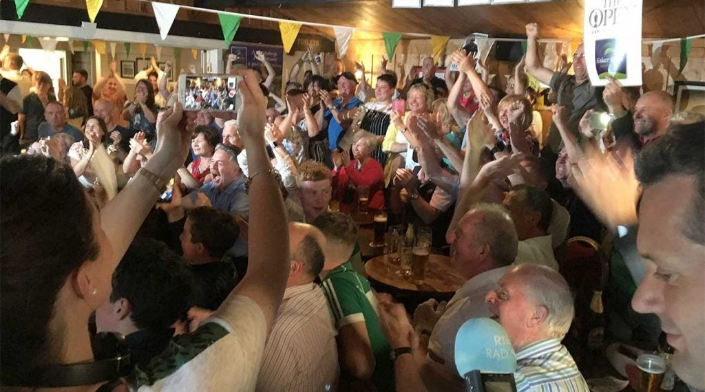 Lowry fans in the Esker Hills clubhouse cheer their man as he clinches his Open Championship victory.
